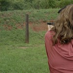 Woman Shooting Target Outdoors