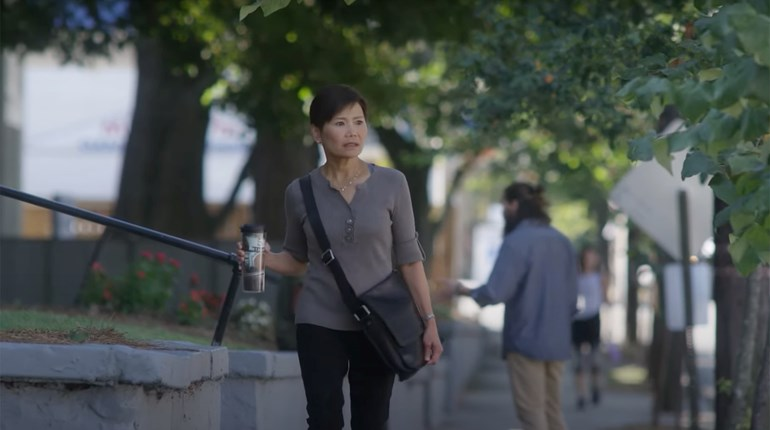 Woman Walking With Concealed Carry Purse