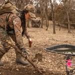 Woman In Camo Creating Deer Scrape
