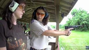 Heidi Rao Instructing Woman On Pistol Range